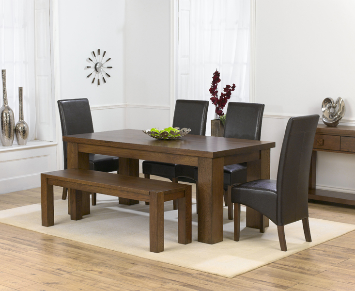 Cheshire Dark solid oak Medium Dining Table Barcelona Bench and 4
